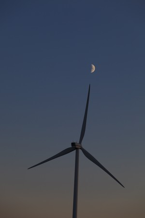 Wind energy turbines at sunset photo