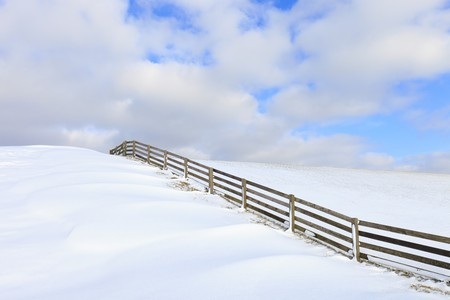 Fresh snow on a dyke in winter Stock Photo - 7421665