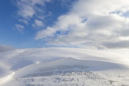 Fresh snow dunes in winter photo