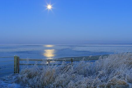 Blue winter landscape in nature with moon and field Stock Photo - 7704193