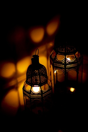 Bright Arabian lantern in a dark room Stock Photo