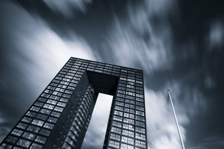 rise to the top: Office building in black and white with beautiful sky