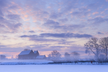 country church: Beautiful winter sunset with snow