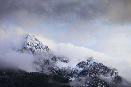 Mountains with snow and storm clouds photo