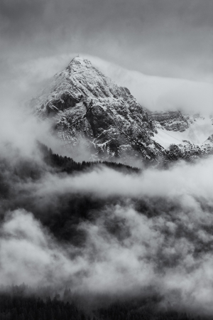 mountains with snow and storm clouds in black and white Stock Photo
