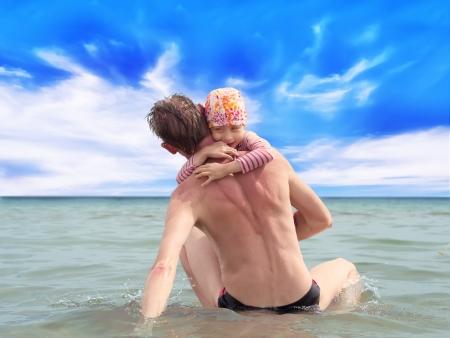 fatherhood: Happy fatherhood in the beach