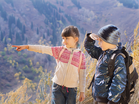 Portrait of hiking caucasian boy and girl photo