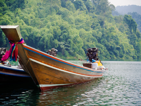 Longtail boats at the pier in Thai, Cheow Lan Lake, Khao Sok National Stock Photo