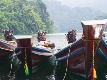 Longtail boats at the pier in Thai, Cheow Lan Lake, Khao Sok National photo