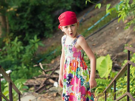 bandana girl: Portrait of little caucasian emotional girl in a bandana