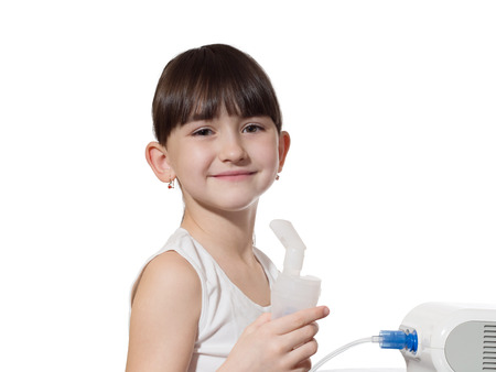 Portrait of young caucasian girl using inhaler isolated on white