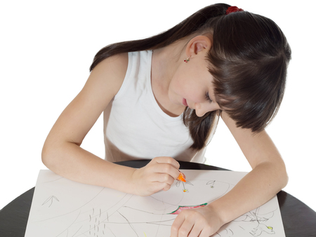 Portrait of young caucasian girl drawing picture by felt-tip pen on the table isolated on white photo