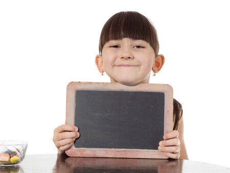 Smiling young caucasian girl holding blank chalkboard isolated on white photo