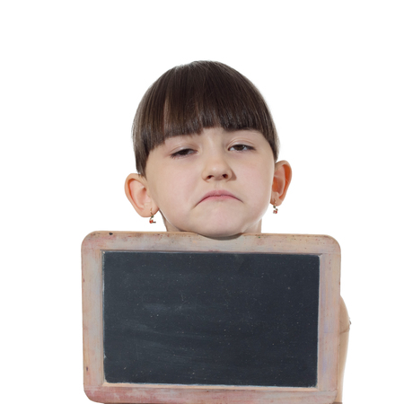 Young caucasian girl holding blank chalkboard isolated on white photo