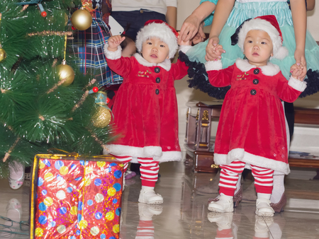 Group of asian children baby girls twins together at celebration Christmas photo