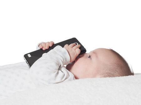 Funny small baby boy holding smartphone isolated photo
