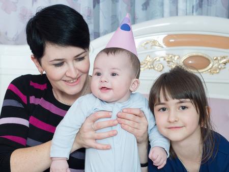 Caucasian family on happy birthday at home photo