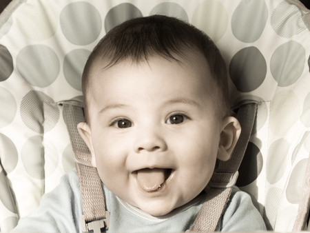 chear: Portrait of small baby boy sitting at the chear Stock Photo