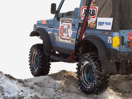 auto hoist: ALMATY, KAZAKHSTAN - DECEMBER 16: Maslow Cup off road festival at Independence Day of Kazakhstan in Sairan reservoir
