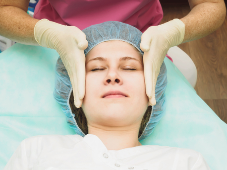 nutrition doctor: Cosmetology procedure for rejuvenation, revitalization, skin nutrition . Doctor making mask of beauty cream. Stock Photo