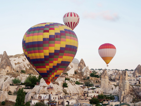 Hot air balloons flying over landscape at Cappadocia, Turkey, Goreme