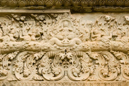 lintel: Ancient Khmer stone lintel carved with images of devatas, or gods, riding on elephants   Bakong Temple, Angkor, Cambodia    Ancient carving, hundreds of years old