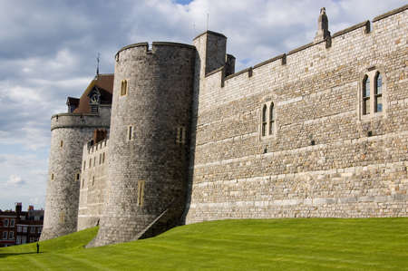 imposing: Imposing walls of Windsor Castle viewed from the town s High Street  Berkshire