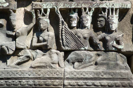 Ancient Khmer bas relief carving of Apsara goddesses playing musical instruments   Banteay Samre temple, part of the Angkor complex, Cambodia Stock Photo - 14240287