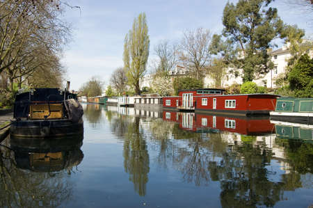 Rows of houseboats and narrow boats on the canal banks at Little Venice, Paddington, West London   The Grand Union Canal meets the Regent s Canal here