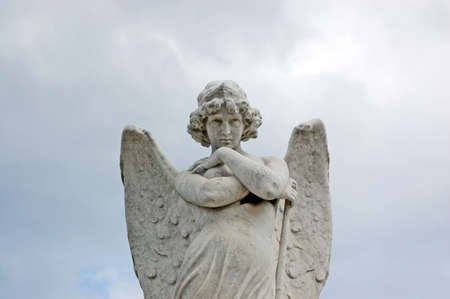 Angel with folded arms  19th century statue in a cemetery