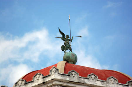 guise: Weathervane in the guise of an angel blowing a trumpet   Roof of the chapel at Havana s Necropolis Christobal Colon