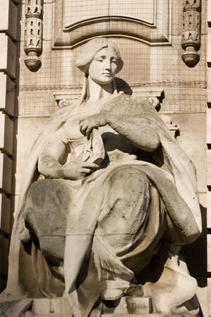 Allegorical figure representing navigation   Ouside of Admiralty Arch between The Mall and Trafalgar Square in Westminster, London  photo