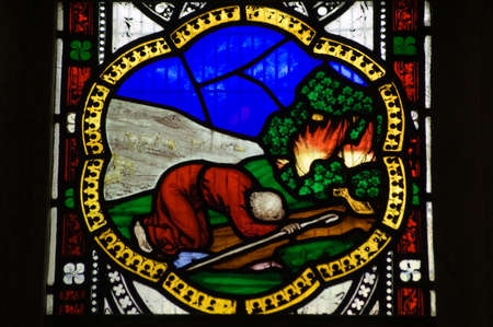 burning bush: Victorian stained glass window showing Moses and the burning bush   window over 100 years old, on public display  Stock Photo