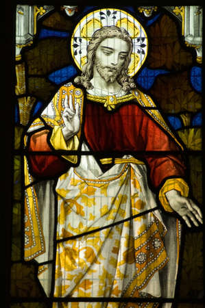 Victorian stained glass window showing Jesus Christ making a blessing  photo