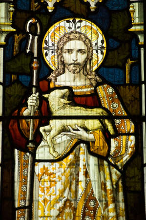 Victorian stained glass window showing Jesus Christ and the lamb of God  Stock Photo