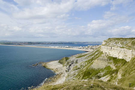 isthmus: View from a stone quarry on the Isle of Portland looking across the Chesil Beach causeway to Weymouth on the Dorset Coast, England  Stock Photo