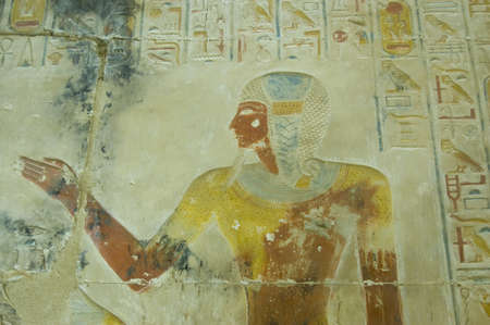 high priest: Ancient Egyptian bas relief  of the Pharaoh Seti I wearing the leopard skin of a High Priest   Wall of Abydos Temple near el Balyana, Egypt  Ancient temple on view to the public for over 2000 years