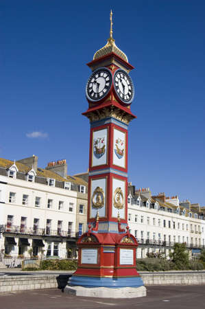 The landmark Jubilee Clock overlooking the beach at Weymouth, Dorset  Erected on the Esplanade in 1887 to mark  the 50th year of Queen Victoria s reign  Stock Photo - 15480294