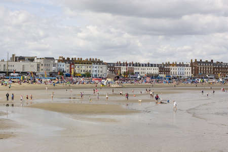 hosted: WEYMOUTH, DORSET, ENGLAND - SEPTEMBER 31: Holiday makers enjoying the last of the Summer sunshine at Weymouth on August 31 2012.  The resort has hosted Olympic sailing events.