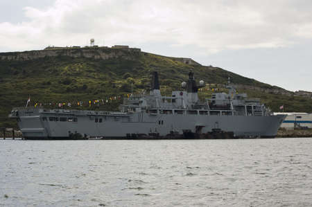bulwark: PORTLAND, DORSET, ENGLAND - AUGUST 31: HMS Bulwark moored in Portland Harbour on August 31 2012.  The Royal Navy landing ship is the command centre for security at the competition for athletes with disabilities Games in the Area.