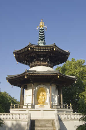 octagonal: Early morning view of the Buddhist Peace Pagoda in Battersea Park, London. Public monument built in 1985. Editorial
