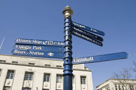 Pedestrian signpost in the centre of Portsmouth directing people to various parts of this naval area  Stock Photo