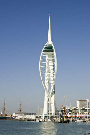 View of the landmark Spinnaker Tower at Gunwharf Quays, Portsmouth.  Viewed from Spice Island, the area has been redeveloped from former Royal Navy dockyards.   View from public footpath.