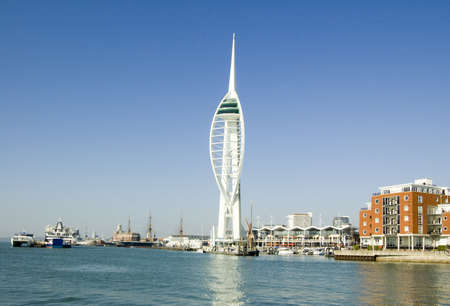 View from Spice Island across the Solent towards Gunwharf Quays in Portsmouth.  Now a shopping centre with the landmark Spinnaker Tower, the area used to have naval warehouses. Editorial