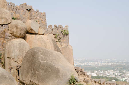 View of the outer walls of Golkonda Fort high above the city of Hyderabad, India