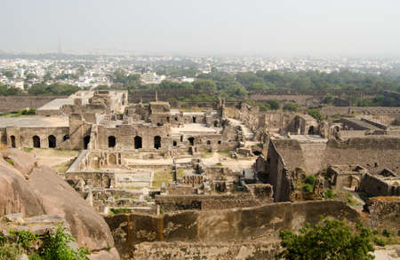 mughal: View of the ruins of Golcanda Fort, Andhra Pradesh, India   The medieval fort was built in the Mughal Empire and still dominates part of the city of Hyderabad