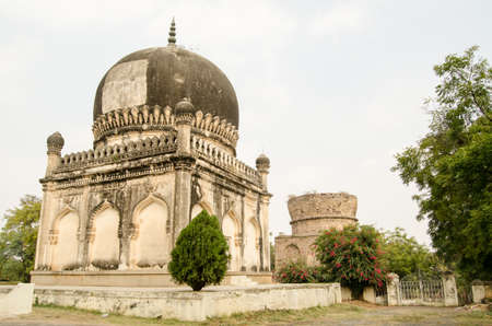 golconda: Two Qutub Shahi tombs built in the Mughal Empire at Golconda, Hyderabad   The Sultan who was to occupy the rear mausoleum died many miles from home and so the Mirza was unfinished