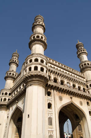 mughal empire: View looking up towards the top of Charminar tower in the centre of Hyderabad, India  The Mughal Empire era tower is the most recognised landmark in the city  Stock Photo