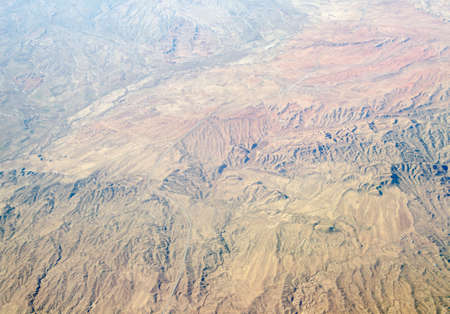 rugged terrain: View from an aeroplane of the rugged terrain west of Mashaad, Northern Iran  Stock Photo