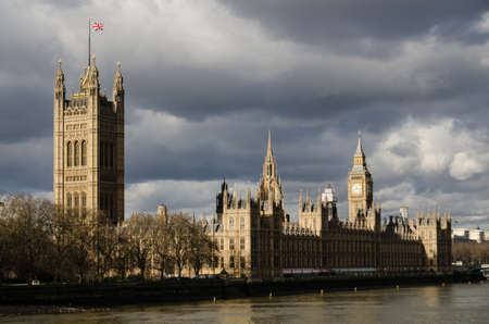 Storm clouds floating ominously over the Palace of Westminster, home to the House of Commons and House of Lords, the UK s legislative bodies  Stock Photo